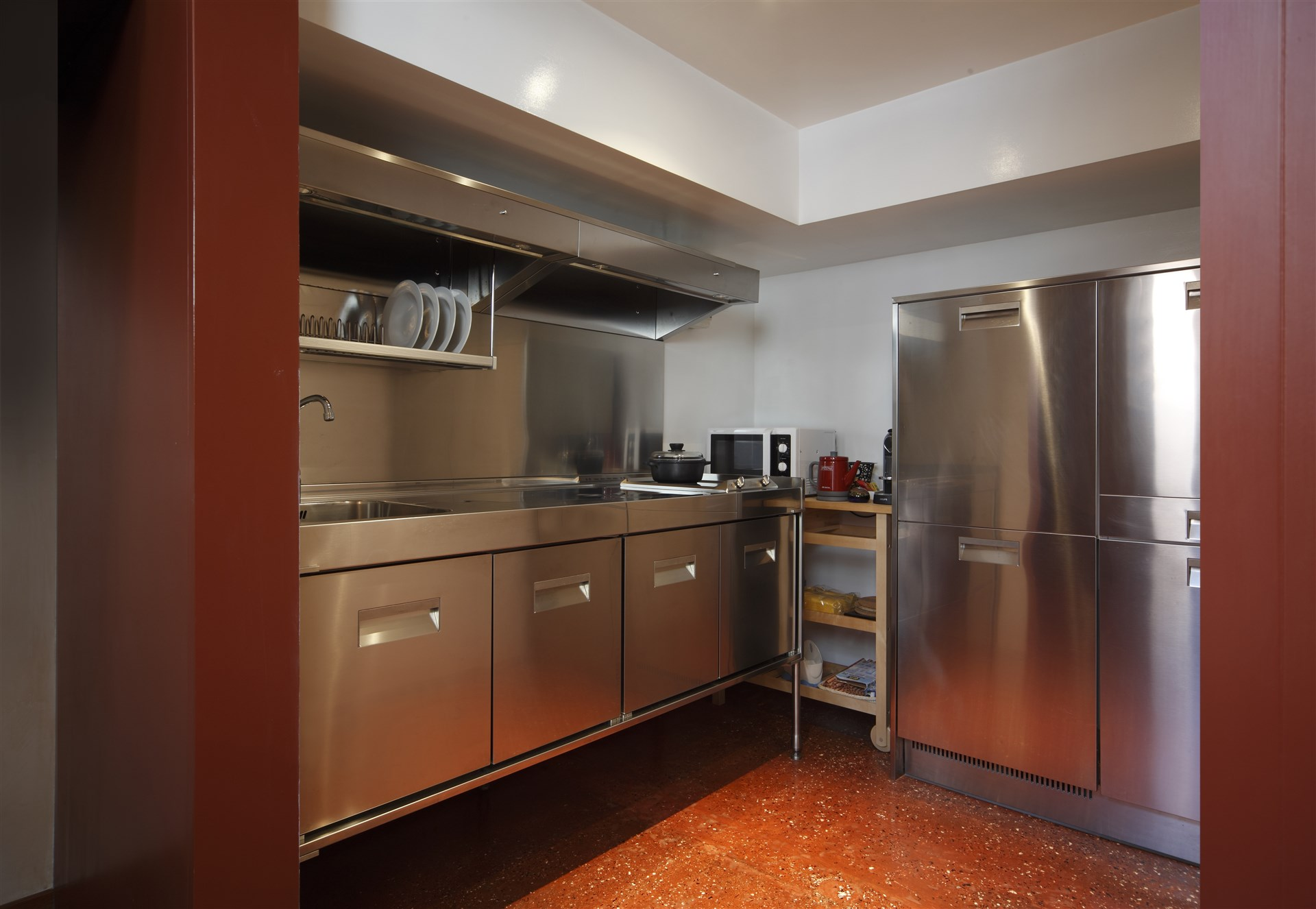 08-The-stainless-Kitchen-has-been-supplied-with-all-the-modern-comfort-microwave-oven-dishwasher-washing-machine-kettle-and-Nespresso-coffee-maker